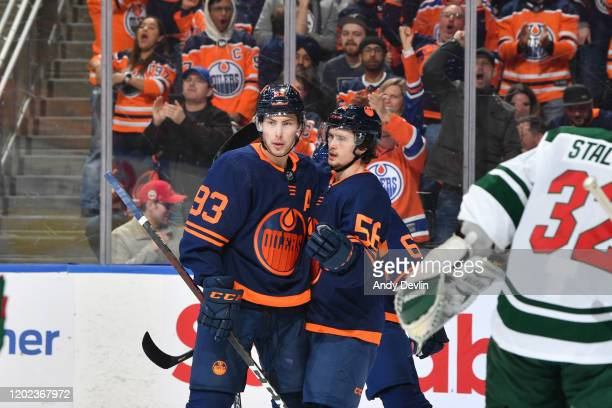 Ryan Nugent-Hopkins and Kailer Yamamoto of the Edmonton Oilers celebrate after a goal during the game against the Minnesota Wild on February 21 at...