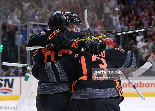 Ryan NugentHopkins celebrates with Johnny Gaudreau of Team North America after scoring a third period goal on Team Russia during the World Cup of...
