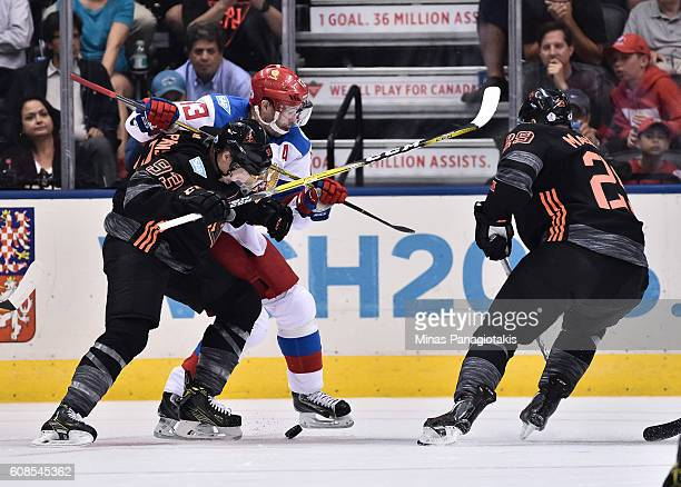 Ryan NugentHopkins of Team North America battles for a loose puck with Pavel Datsyuk of Team Russia during the World Cup of Hockey 2016 at Air Canada...