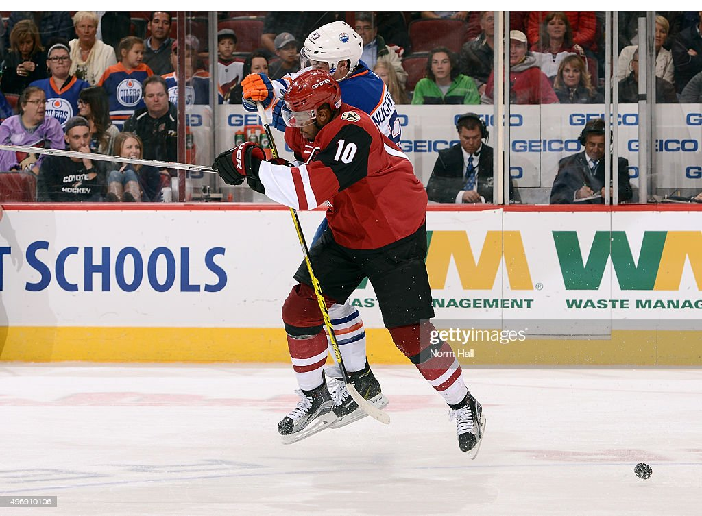 Ryan Nugent-Hopkins #93 of the Edmonton Oilers and Anthony Duclair #10 of the Arizona Coyotes collide during the third period at Gila River Arena on November 12, 2015 in Glendale, Arizona.