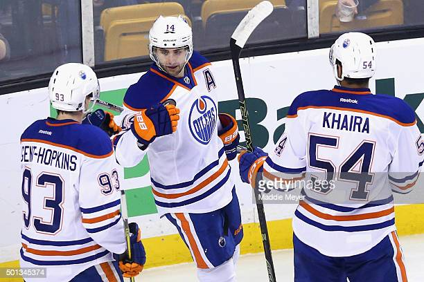 Ryan NugentHopkins of the Edmonton Oilers and Jujhar Khaira congratulate Jordan Eberle after he scored against the Boston Bruins during the first...