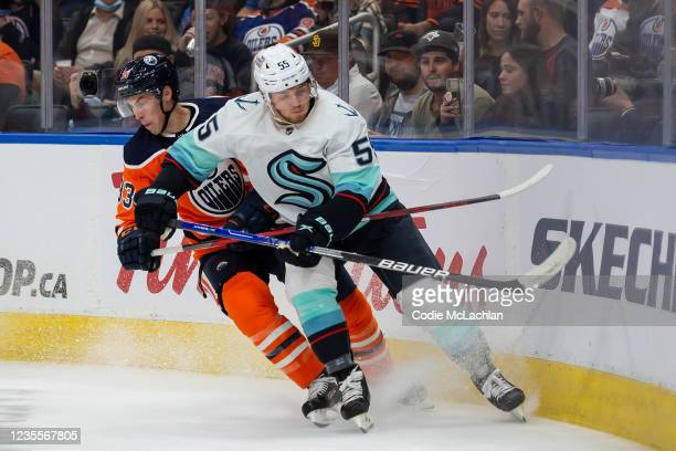 Ryan Nugent-Hopkins of the Edmonton Oilers battles against Jeremy Lauzon of the Seattle Kraken during the second period in a preseason game at Rogers...
