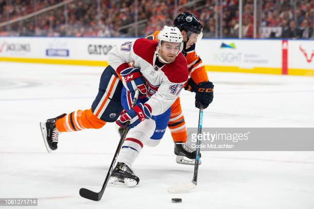 Ryan NugentHopkins of the Edmonton Oilers battles against Kenny Agostino of the Montreal Canadiens during the third period at Rogers Place on...