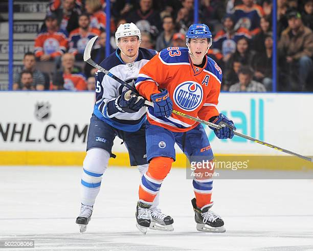 Ryan NugentHopkins of the Edmonton Oilers battles for position against Mark Scheifele the Winnipeg Jets on December 21 2015 at Rexall Place in...