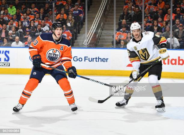 Ryan NugentHopkins of the Edmonton Oilers battles for the puck against Colin Miller of the Vegas Golden Knights on April 5 2018 at Rogers Place in...