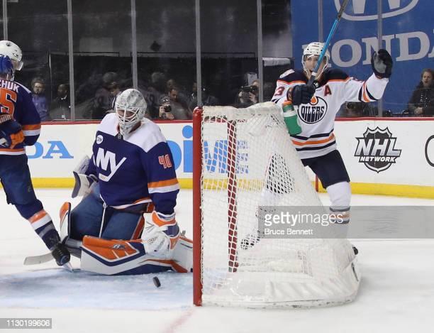 Ryan NugentHopkins of the Edmonton Oilers celebrates a third period powerplay goal by Leon Draisaitl against Robin Lehner of the New York Islanders...
