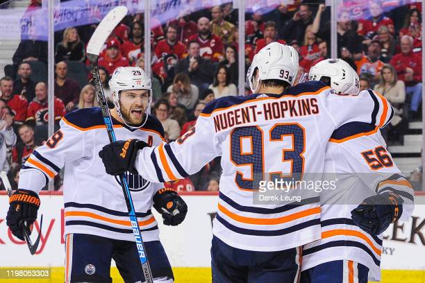 Ryan NugentHopkins of the Edmonton Oilers celebrates with his teammates after scoring against the Calgary Flames during an NHL game at Scotiabank...