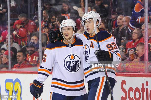 Ryan Nugent-Hopkins of the Edmonton Oilers celebrates with Kailer Yamamoto after scoring against the Calgary Flames during an NHL game at Scotiabank...