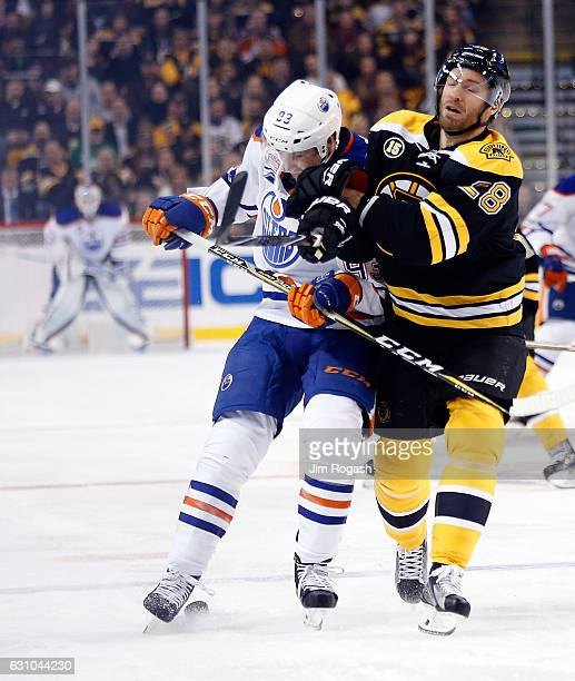 Ryan NugentHopkins of the Edmonton Oilers collides with Dominic Moore of the Boston Bruins in the third period at TD Garden on January 5 2017 in...