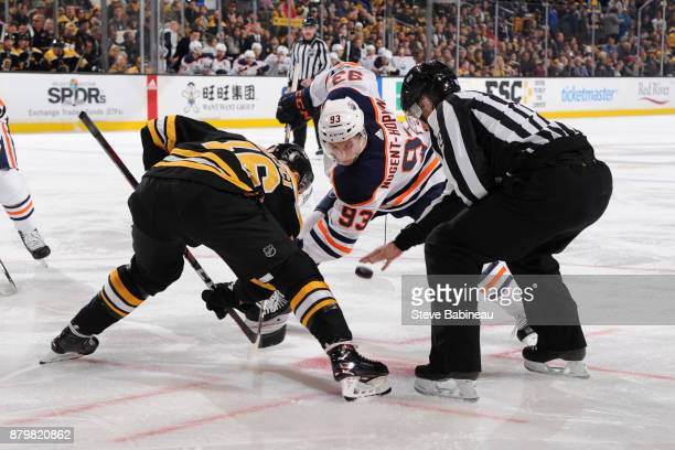 Ryan NugentHopkins of the Edmonton Oilers faces off against David Krejci of the Boston Bruins at the TD Garden on November 26 2017 in Boston...