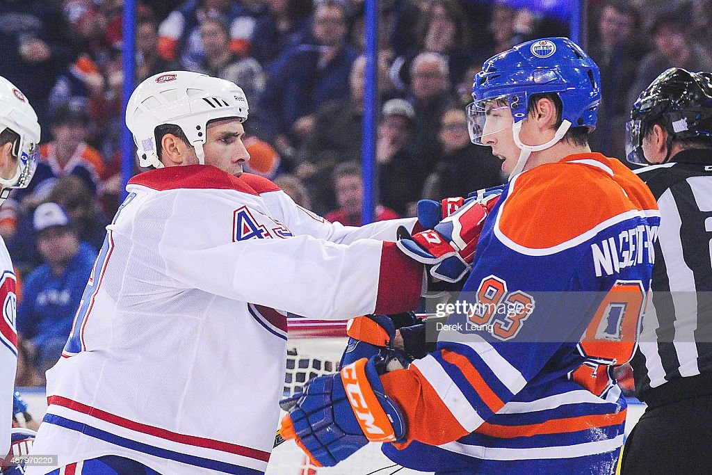 Ryan Nugent-Hopkins #93 of the Edmonton Oilers gets shoved after the whistle by Mike Weaver #43 of the Montreal Canadiens during an NHL game at Rexall Place on October 27, 2014 in Edmonton, Alberta, Canada. The Oilers defeated the Canadiens 3-0.