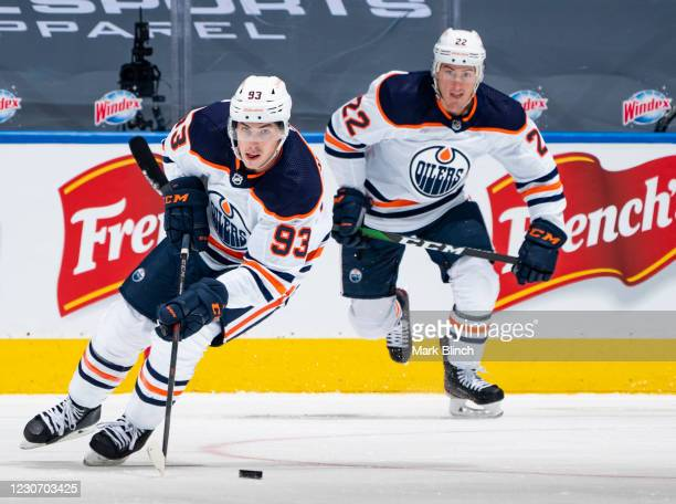 Ryan Nugent-Hopkins of the Edmonton Oilers plays the puck against the Toronto Maple Leafs during the second period at the Scotiabank Arena on January...