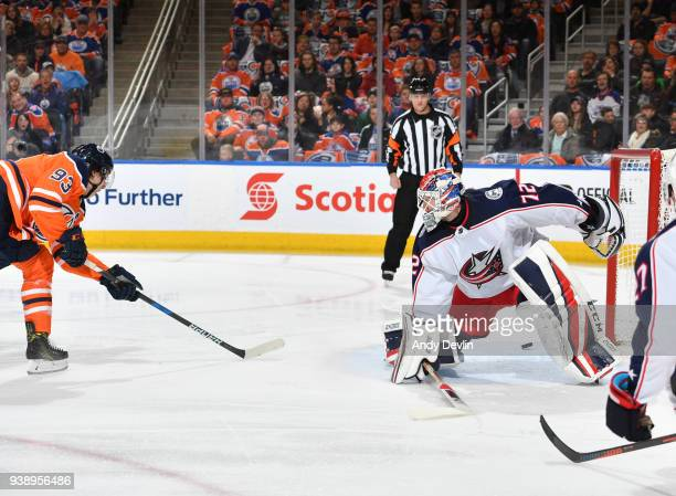 Ryan NugentHopkins of the Edmonton Oilers scores a goal on Sergei Bobrovsky of the Columbus Blue Jackets on March 27 2018 at Rogers Place in Edmonton...