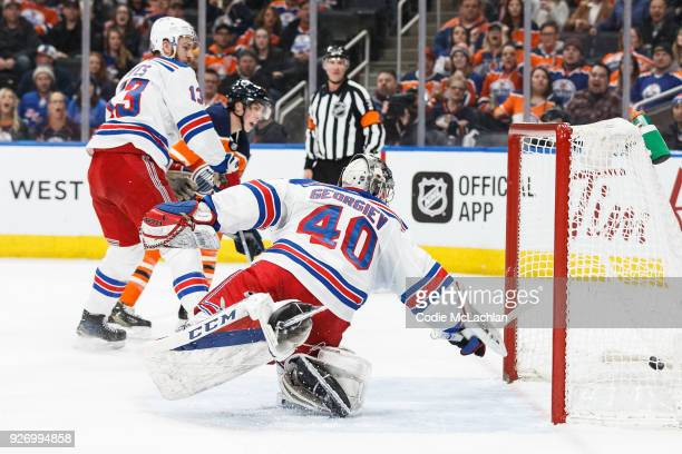Ryan NugentHopkins of the Edmonton Oilers scores against goaltender Alexandar Georgiev of the New York Rangers at Rogers Place on March 3 2018 in...