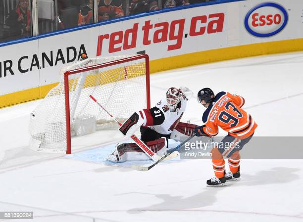 Ryan NugentHopkins of the Edmonton Oilers scores the game winning goal on Scott Wedgewood of the Arizona Coyotes on November 28 2017 at Rogers Place...