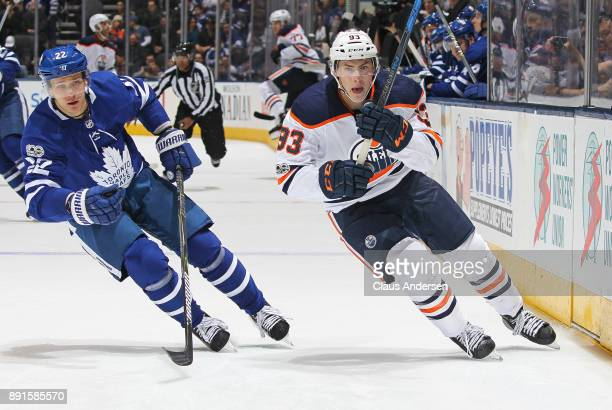 Ryan NugentHopkins of the Edmonton Oilers skates against Nikita Zaitsev of the Toronto Maple Leafs during an NHL game at the Air Canada Centre on...
