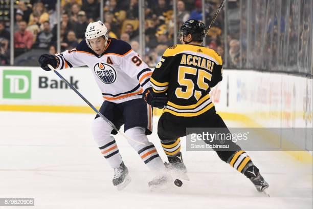 Ryan NugentHopkins of the Edmonton Oilers skates against Noel Acciari of the Boston Bruins at the TD Garden on November 26 2017 in Boston...