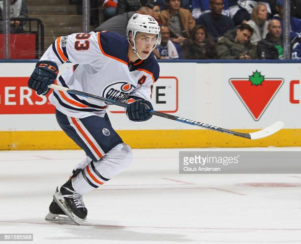 Ryan NugentHopkins of the Edmonton Oilers skates against the Toronto Maple Leafs during an NHL game at the Air Canada Centre on December 10 2017 in...