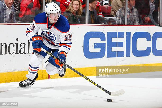 Ryan NugentHopkins of the Edmonton Oilers skates with the puck during the NHL game against the Chicago Blackhawks on March 06 2015 at the United...