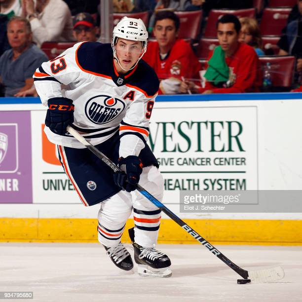 Ryan NugentHopkins of the Edmonton Oilers skates with the puck against the Florida Panthers at the BBT Center on March 17 2018 in Sunrise Florida