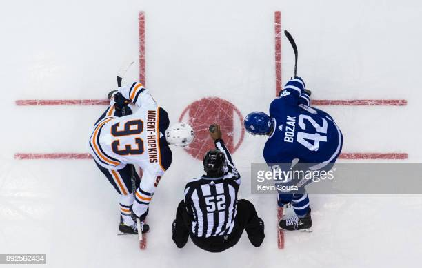 Ryan NugentHopkins of the Edmonton Oilers takes a faceoff against Tyler Bozak of the Toronto Maple Leafs during the third period at the Air Canada...