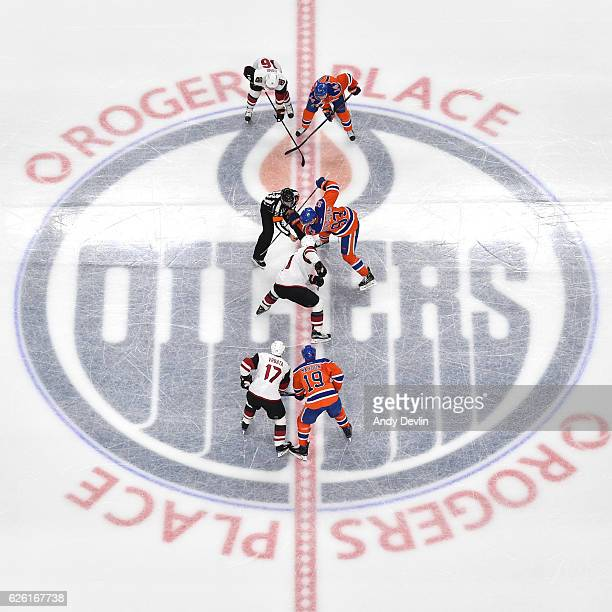 Ryan NugentHopkins Patrick Maroon and Jordan Eberle of the Edmonton Oilers line up for a face off against Radim Vrbata Martin Hanzal and Max Domi of...