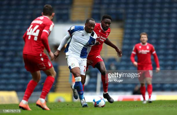 Ryan Nyambe of Blackburn Rovers battles with Sammy Ameobi of Nottingham Forest during the Sky Bet Championship match between Blackburn Rovers and...