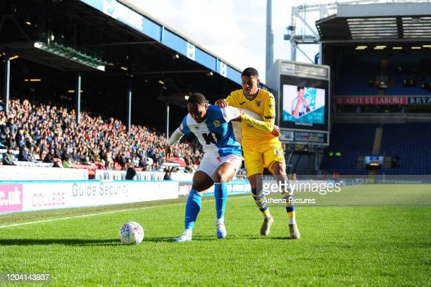 Ryan Nyambe of Blackburn Rovers under pressure from Rhian Brewster of Swansea City during the Sky Bet Championship match between Blackburn Rovers and...
