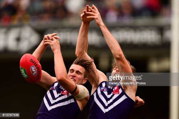 Ryan Nyhuis of the Dockers competes for a mark with teammate Joel Hamling of the Dockers during the 2017 AFL round 17 match between the Fremantle...