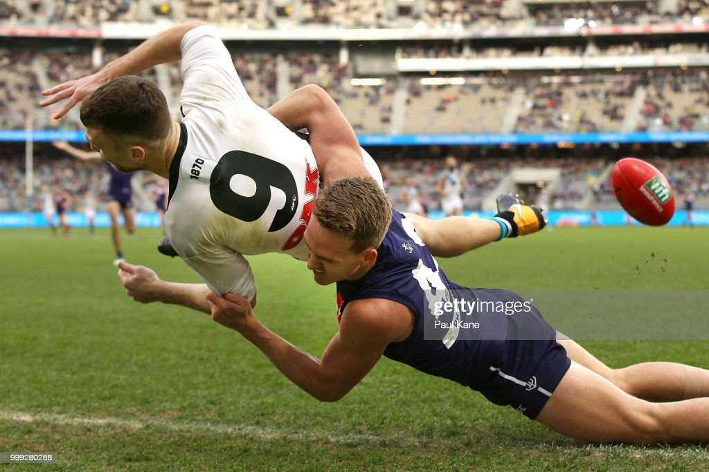 Ryan Nyhuis of the Dockers tackles Robbie Gray of the Power during the round 17 AFL match between the Fremantle Dockers and the Port Adelaide Power at Optus Stadium on July 15, 2018 in Perth, Australia.