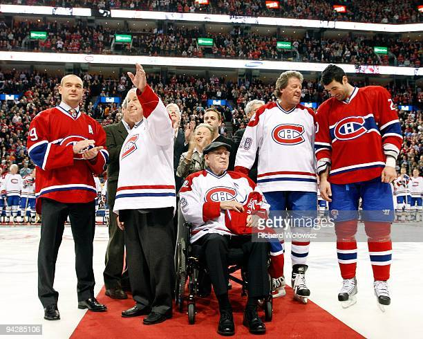 Ryan O'Byrne of the Montreal Canadiens removes his old jersey and now the retired number three belonging to Emile Bouchard during the Centennial...