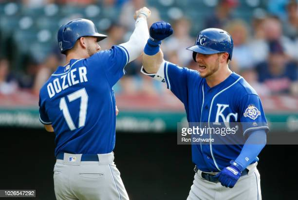 Ryan O'Hearn of the Kansas City Royals celebrates with Hunter Dozier#17 after hitting a two run home run off starting pitcher Adam Plutko of the...