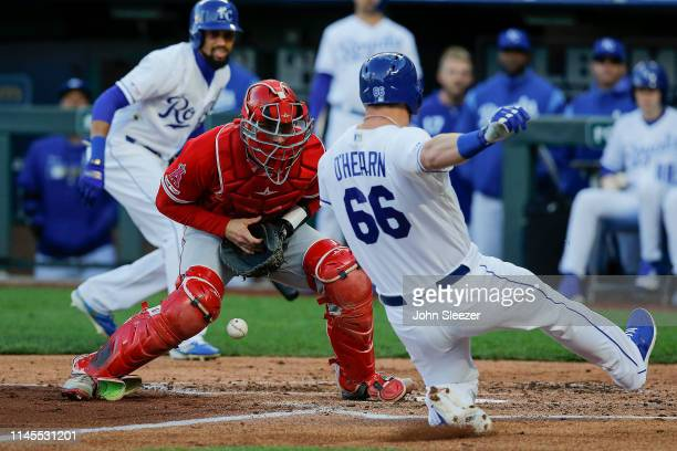 Ryan O'Hearn of the Kansas City Royals scores as Jonathan Lucroy of the Los Angeles Angels of Anaheim drops the ball at the plate on a hit by Martin...