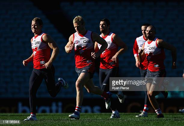 Ryan O'Keefe and Paul Bevan of the Swans train during a Sydney Swans AFL training session at Sydney Cricket Ground on July 5 2011 in Sydney Australia