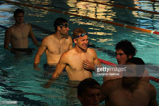 Ryan O'Keefe of the Swans and team mates walk lenths of the pool during a Sydney Swans AFL recovery session at Ian Thorpe Aquatic Centre on June 26...