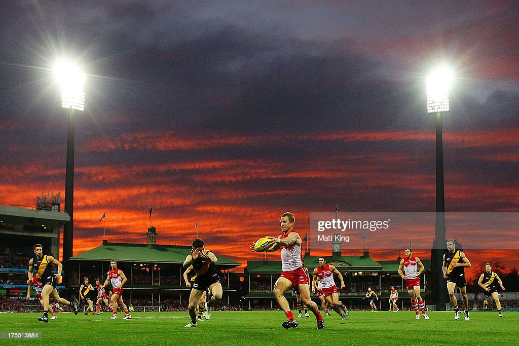 Ryan O'Keefe of the Swans clears the ball during the round 18 AFL match between the Sydney Swans and the Richmond Tigers at SCG on July 28, 2013 in Sydney, Australia.