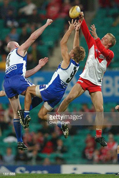 Ryan O'Keefe of the Swans contests a mark with Jess Sinclair of the Kangaroos during the round 19 AFL match between the Sydney Swans and the...