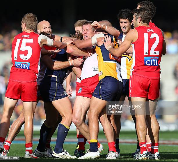 Ryan O'Keefe of the Swans gets wrapped up in a tackle during the round 16 AFL match between the West Coast Eagles and the Sydney Swans at Patersons...