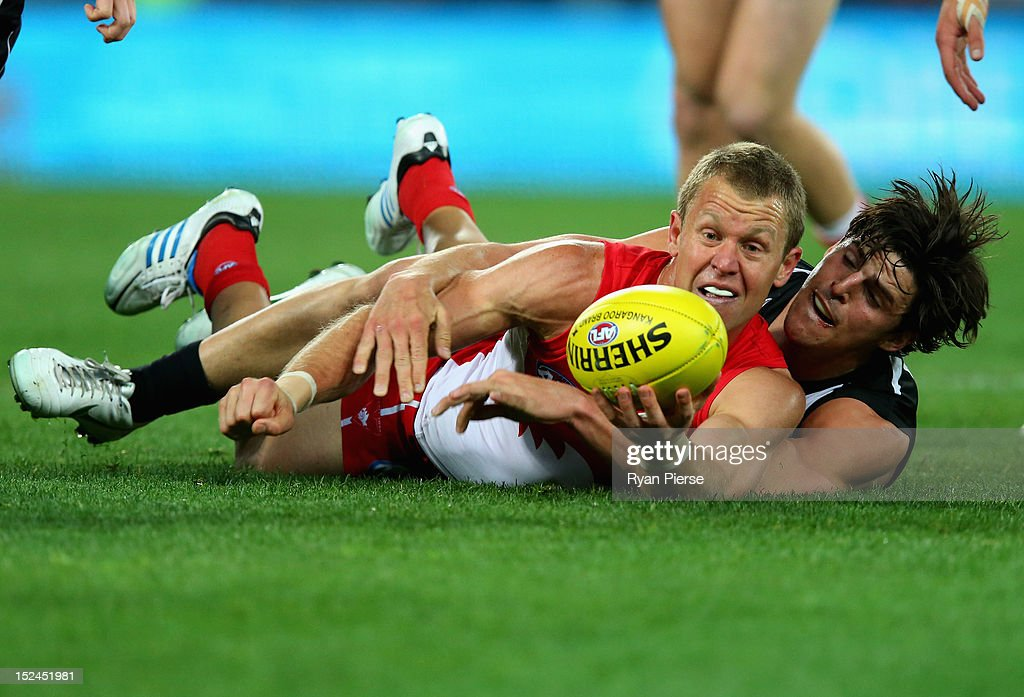 Ryan O'Keefe of the Swans is tackled by Scott Pendlebury of the Magpies during the second AFL Preliminary Final match between the Sydney Swans and the Collingwood Magpies at ANZ Stadium on September 21, 2012 in Sydney, Australia.