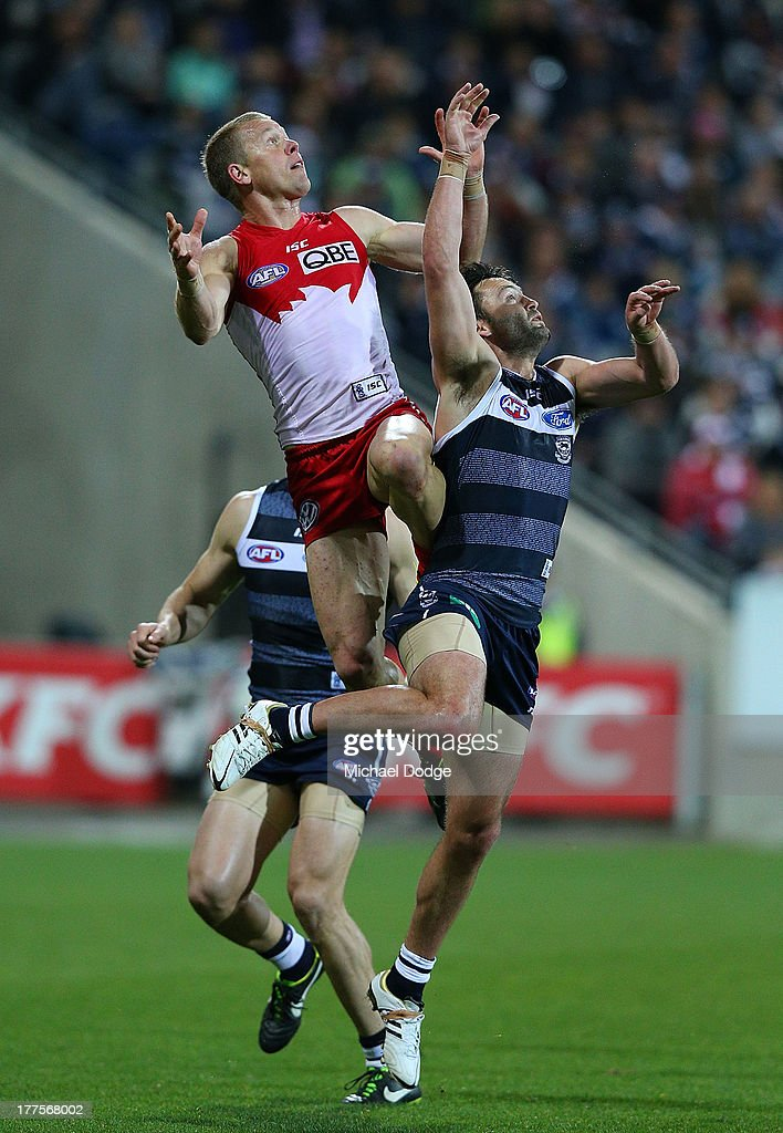 Ryan O'Keefe of the Swans marks the ball against Jimmy Bartel of the Cats during the round 22 AFL match between the Geelong Cats and the Sydney Swans at Simonds Stadium on August 24, 2013 in Geelong, Australia.