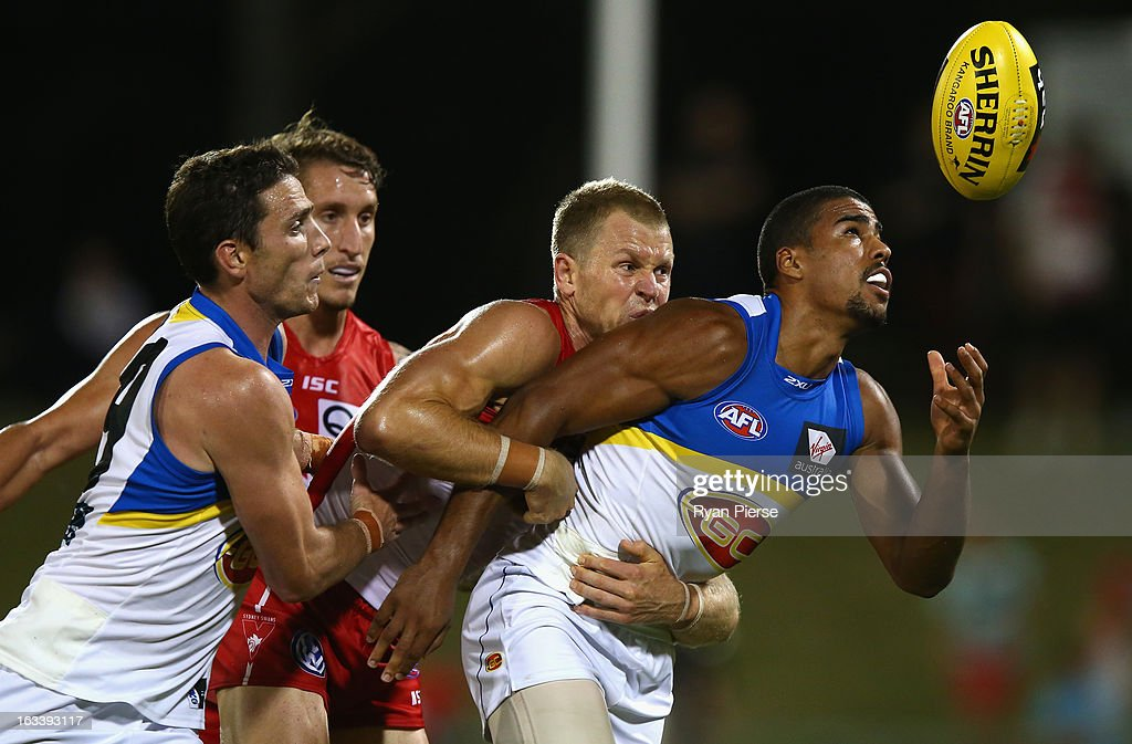 Ryan O'Keefe of the Swans tackles Joel Wilkinson of the Suns during the round three NAB Cup AFL match between the Sydney Swans and the Gold Coast Suns at Blacktown International Sportspark on March 9, 2013 in Sydney, Australia.