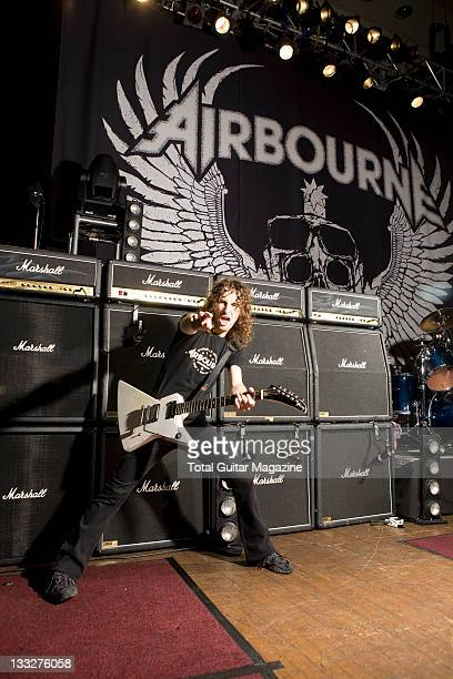 Ryan O'Keeffe from Airbourne poses with a Gibson guitar March 30 2010