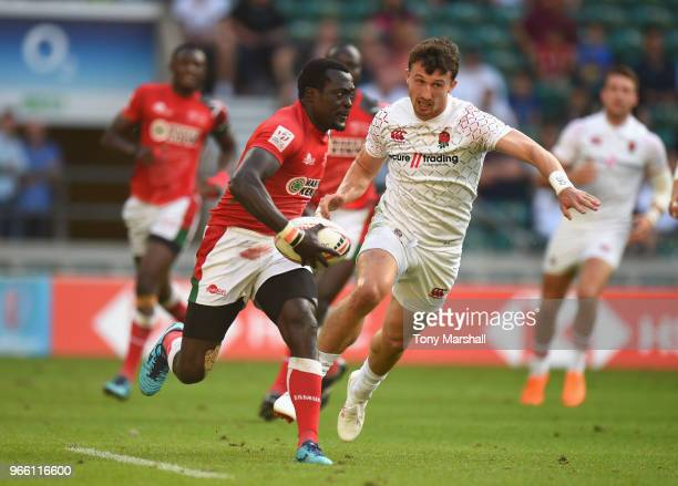 Ryan Olowofela of England is tackled by Oscar Ayodi of Kenya during the pool match between England and Kenya on Day One of the HSBC London Sevens at...