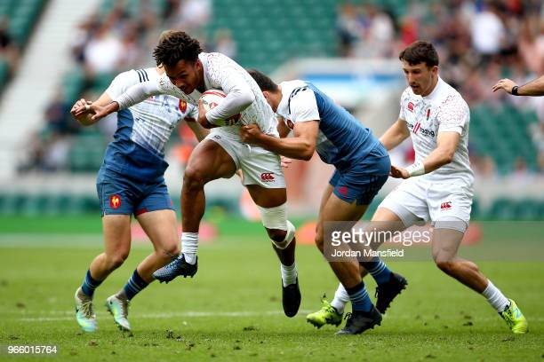 Ryan Olowofela of England is tackled by Paulin Riva of France on day one of the HSBC London Sevens at Twickenham Stadium on June 2 2018 in London...