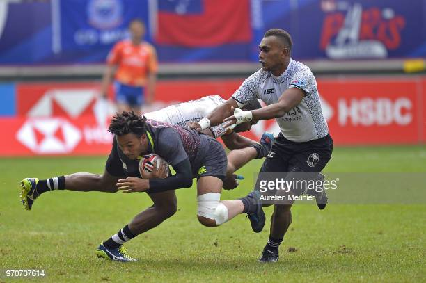 Ryan Olowofela of England is tackled during match between england and Fiji at the HSBC Paris Sevens stage of the Rugby Sevens World Series at Stade...