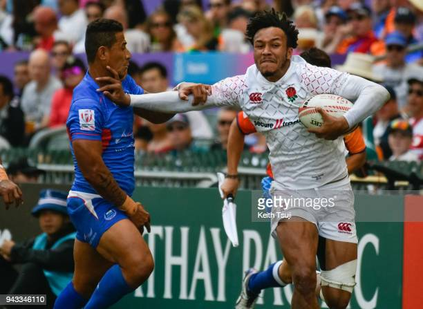Ryan Olowofela of England makes a break in the Semifinal match against Samoa during the Hong Kong Sevens on April 8 2018 in Hong Kong