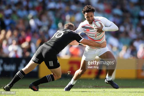 Ryan Olowofela of England takes on the defence in the game against New Zealand during day three of the 2018 Sydney Sevens at Allianz Stadium on...