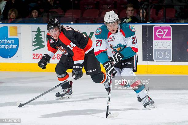 Ryan Olsen of the Kelowna Rockets skates with the puck while back checked by Miles Koules of the Medicine Hat Tigers on January 24 2014 at Prospera...