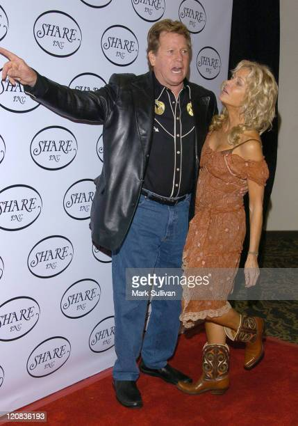 Ryan O'Neal and Farrah Fawcett during 51st Annual Boomtown Party at Century Plaza Hotel in Century City California United States