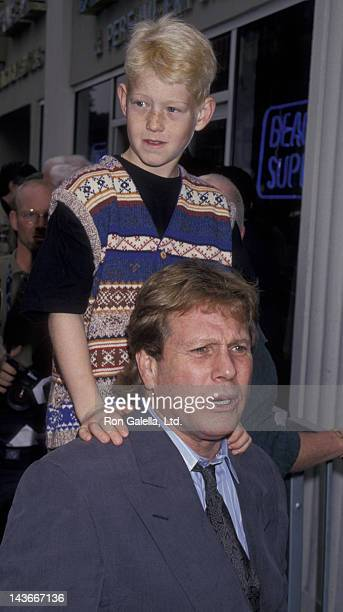 Ryan O'Neal and Redmond O'Neal attend Hollywood Walk of Fame Star Ceremony Honoring Farrah Fawcett on February 23 1995 in Hollywood California